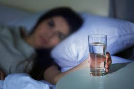 Showing water is drank at night time before bedtime